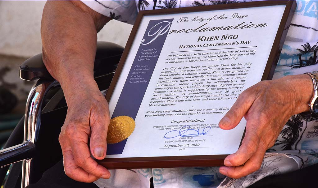 Despite his age 109-year-old Khen Ngo's skin is relatively youthful. He holds a city proclamation.