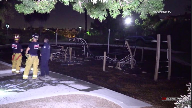 Fire crew examines remains of torched playground at Chula Vista Veterans Park.