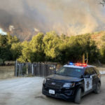 San Diego Sheriff's deputies patrol an evacuation area