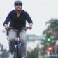 Supervisor Natan Fletcher riding a bike.