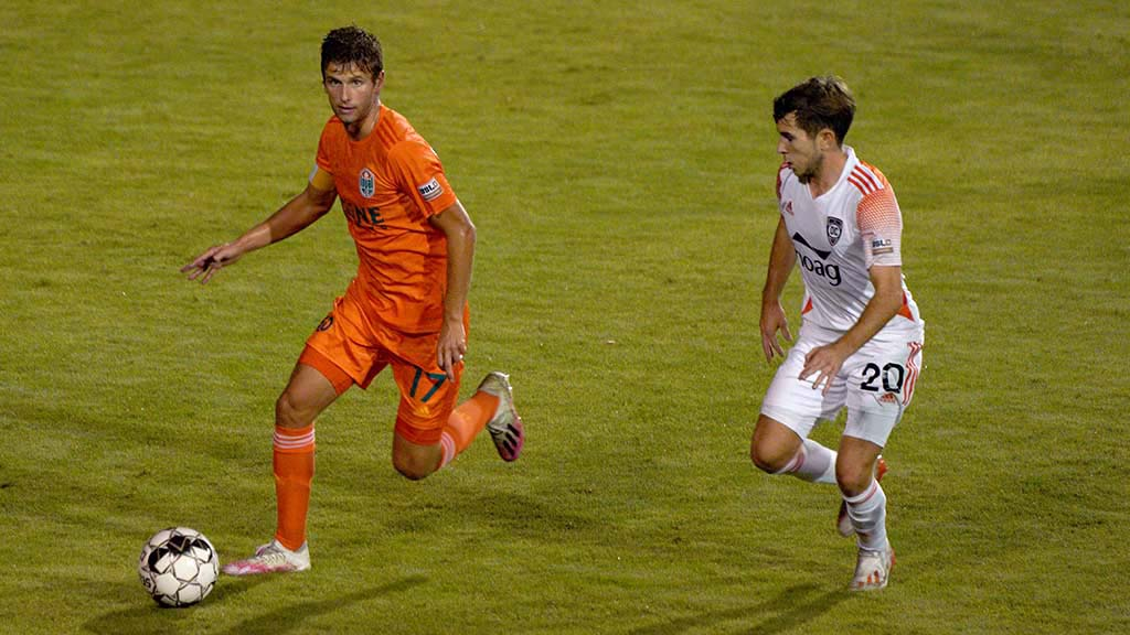 Loyal player Collin Martin advances the ball in a match between the San Diego team and Orange County Soccer Club.
