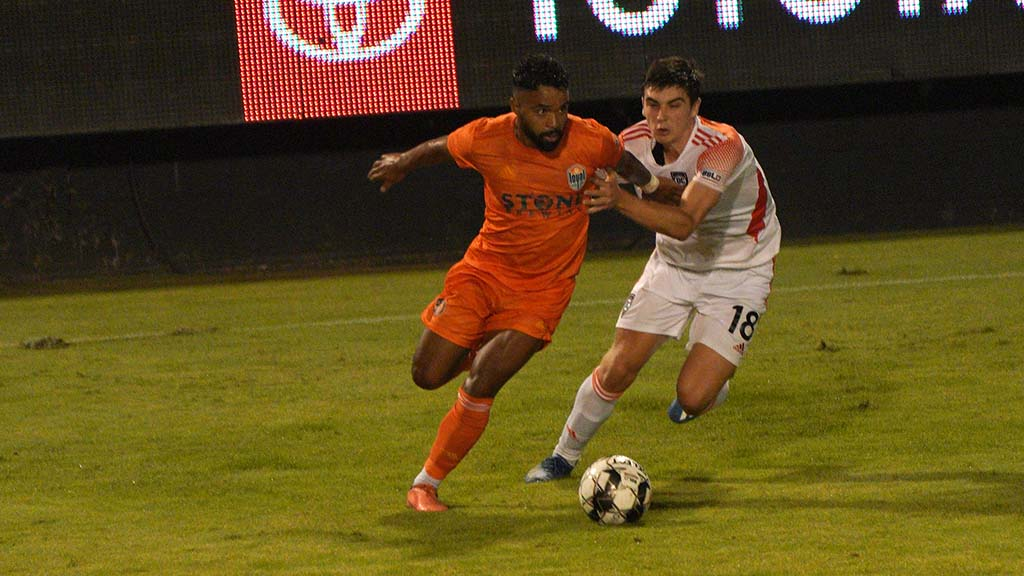 Loyal player Elijah Martin controls the ball in the match against the Orange County club.
