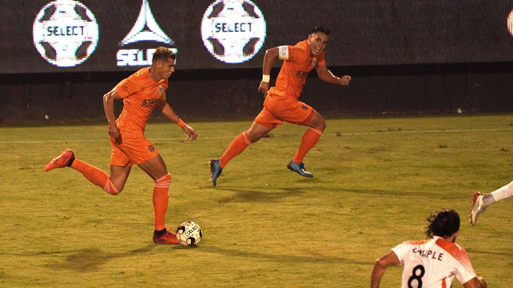 Loyal player Miguel Berry advances the ball toward the goal.