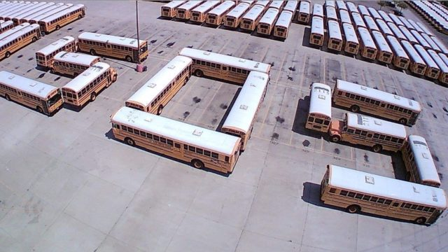 Buses spell out SOS.