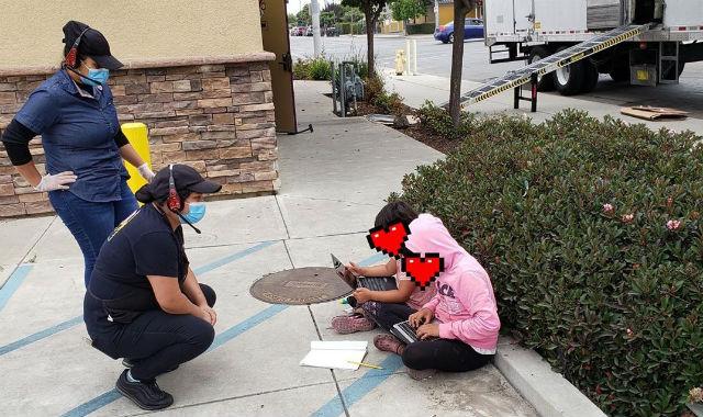 Girls using Taco Bell wifi in Salinas