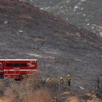 A Cal Fire crew makes it's way back to trucks on the sixth day of firefighting in the Valley Fire.