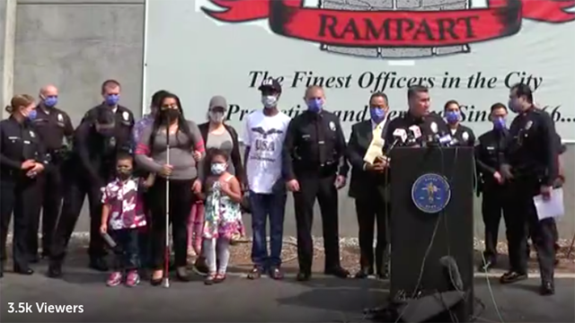 Would-be victim's family stood with Los Angeles police during press conference on case.