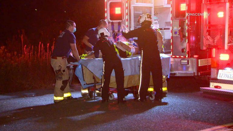 Crash victim loaded into ambulance