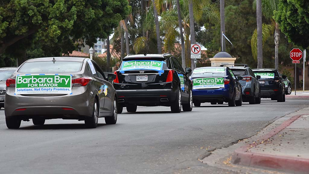 Volunteers for the Barbara Bry for mayor campaign drive in a caravan throughout Balboa Park.