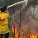 A Cal Fire firefighter on the line at Barnett Vineyards