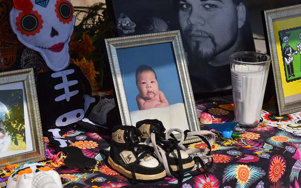 A photo of an infant was on display at an altar for the Día de los Muertos observance.