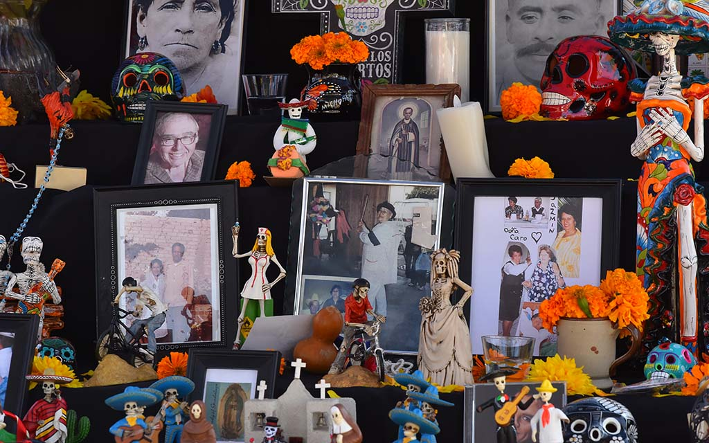 Community members were invited to add photos of loved ones to a community altar.