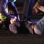 Paramedics assist a crash victim