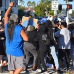 Pushing and shoving took place between Defend East County members and protesters at an August march in La Mesa.