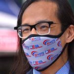 San Diego County Registrar of Voters Michael Vu sported a branded face mask outside his Kearny Mesa offices on the final day of voter registration for Nov, 3 election.