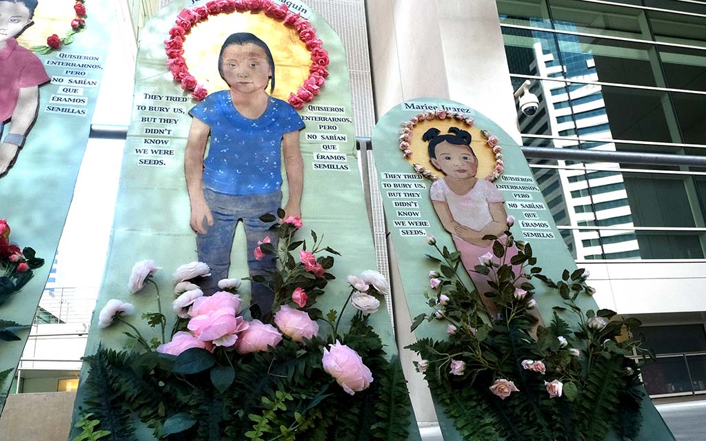 Portraits of children who have died in the custody of ICE were displayed in front of federal courthouses in downtown San Diego.