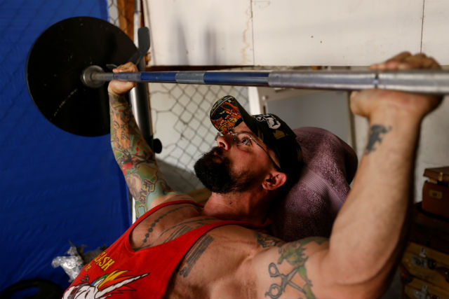 Paulo Batista works out in his garage