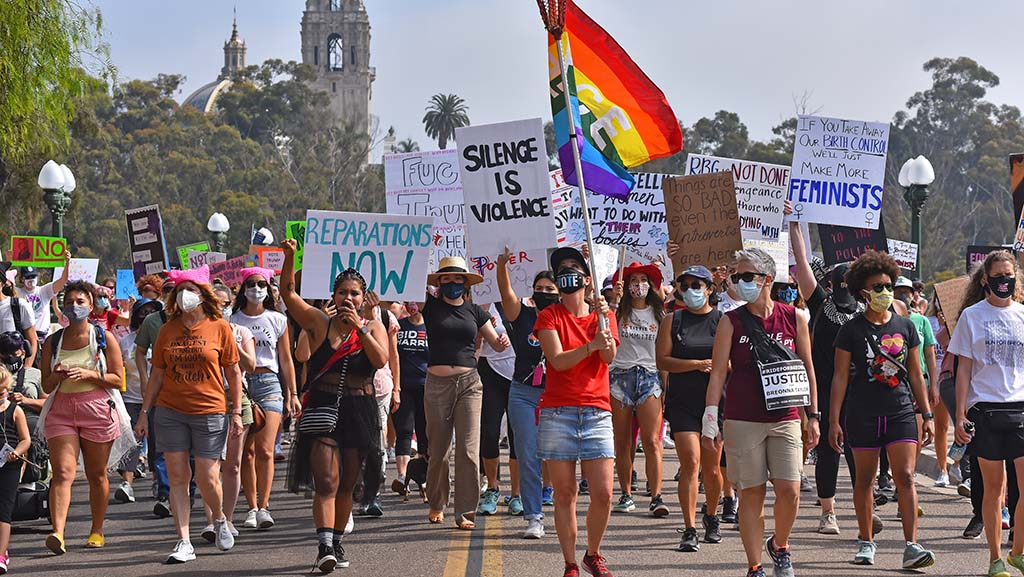 About 300 people, mostly women advocated for women's rights as they marched across the Cabrillo Bridge by Balboa Park.