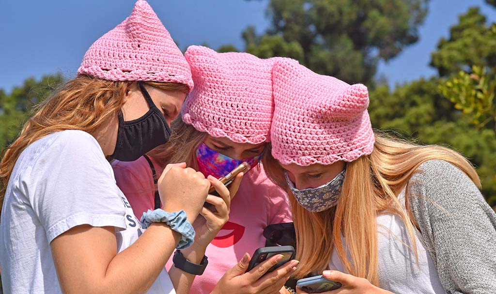 Pink pussy hats, a common sight at women's marches, were worn by a number of women in the group.