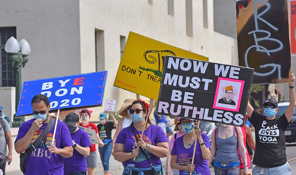 Many marchers carried signs in honor of the late Supreme Court Justice Ruth Bader Ginsburg.