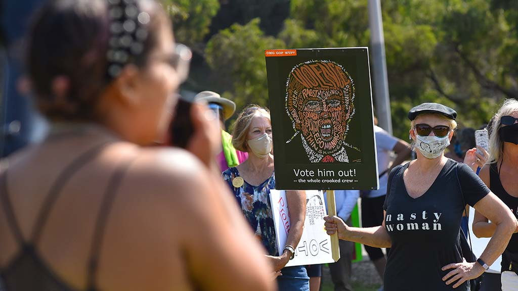 About 300 people, mostly women, gathered in Balboa Park to press for women's rights.