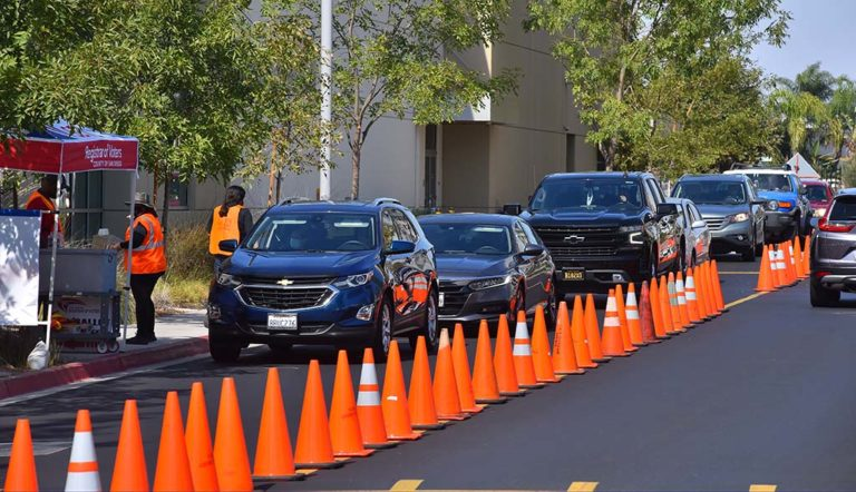Cars queue up to drop off mail-in ballots at the Registrar of Voters office in Kearny Mesa.