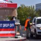 Voters drop off a mail-in ballot at the San Diego Registrar of Voters office in Kearny Mesa.