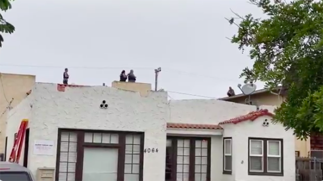 Police negotiators talk to man on City Heights rooftop.