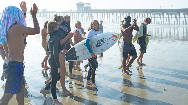 Caitlin Simmers of Oceanside rode into first place among Qualifying Series (QS) teammates at the Nissan Super Girl Surf Pro.