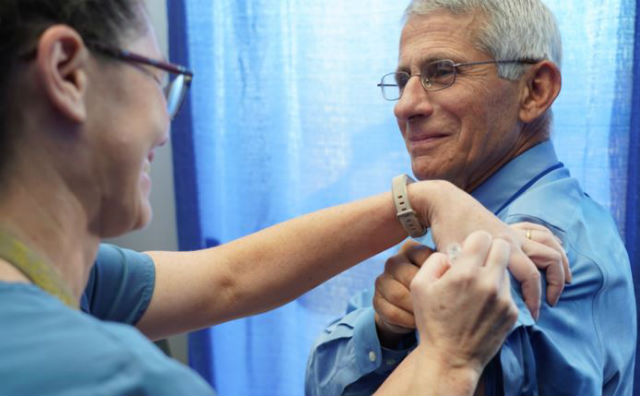 Dr. Anthony Fauci gets a flu shot