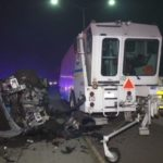 Car wreckage next to zipper machine