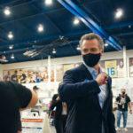 Gov. Gavin Newsom greets a poll worker