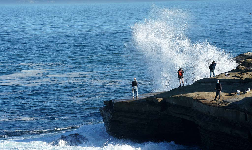 People gathered along the coast near La Jolla Cove on the first day of King Tides.