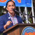 Assemblyman Todd Gloria speaks at a car rally downtown on Election Day.