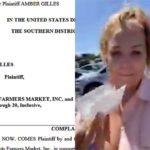 "Amber Gilles displays what she calls her ""medical exemption"" allowing her to enter Sprouts without a face mask."