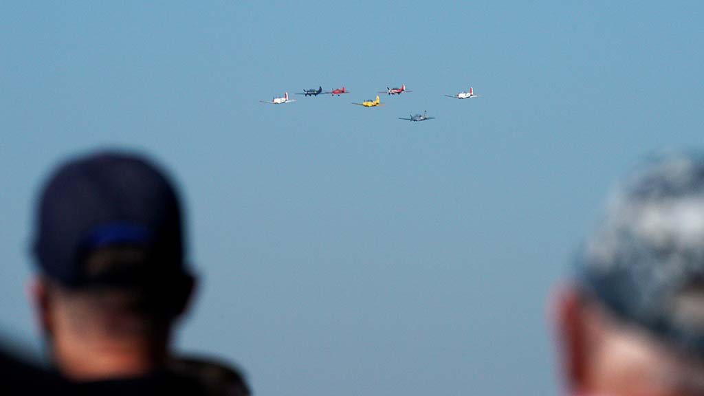 Vintage aircraft do a flyover over San Diego Bay as part of Veterans Day events during the pandemic.