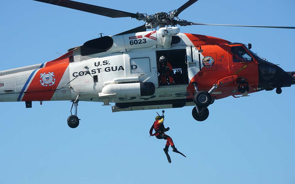 A USS Coast Guard diver descends into the San Diego Bay during a rescue demonstration in the San Diego Bay.