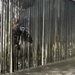 Unidentified Mexican national is shown stuck to border wall on U.S. side before rescue.