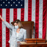 Speaker of the House Nancy Pelosi holds the gavel in the air