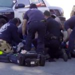 San Diego police and EMTs work to revive shooting victim at 45th Street and Keeler Avenue.